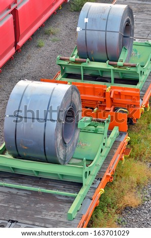 Cargo train platform with role steel seen from above - stock photo