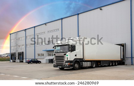 Cargo Transportation - Truck in the warehouse - stock photo