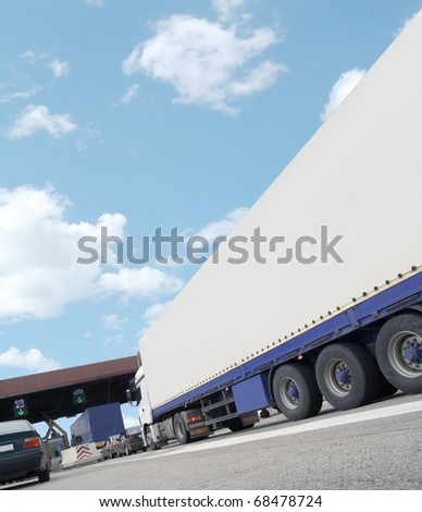 Cargo truck on highway toll payment with empty space for you logo - stock photo