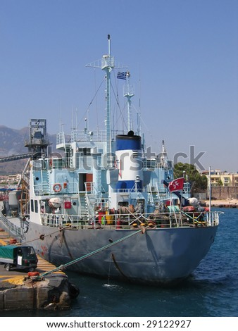 cargo vessel at harbor - stock photo