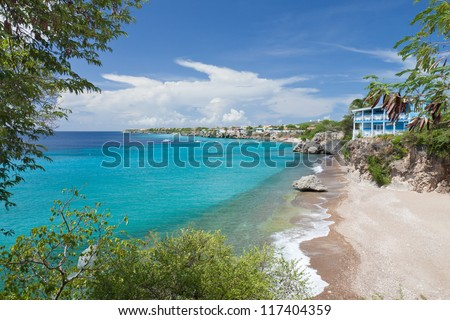 Caribbean bay with turquoise water. This image of a beautiful Caribbean bay with clear turquoise water was taken at West Punt in Curacao, Netherlands Antilles. - stock photo