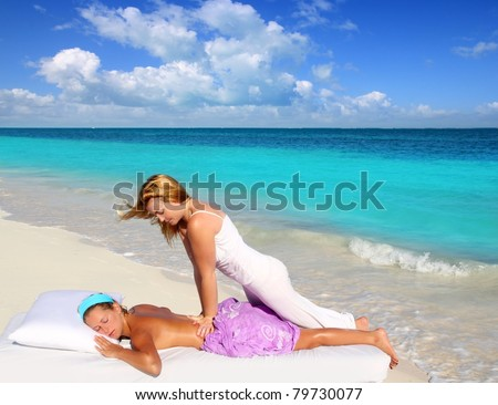 Caribbean beach massage shiatsu waist pressure woman outdoor paradise - stock photo