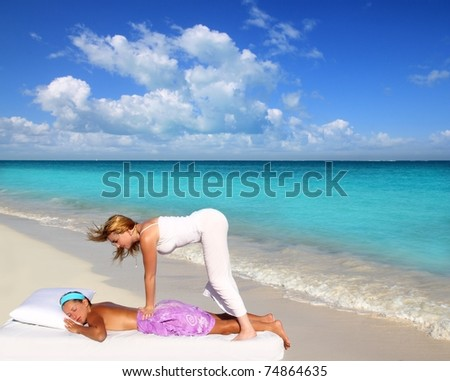 Caribbean beach massage shiatsu waist pressure woman outdoor paradise [Photo Illustration]