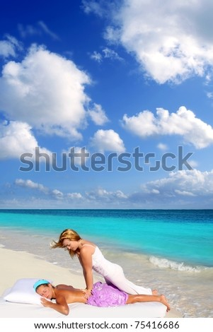 Caribbean beach massage shiatsu waist pressure woman outdoor paradise [Photo Illustration] - stock photo