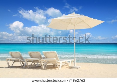 Caribbean beach parasol white umbrella and hammocks turquoise sea