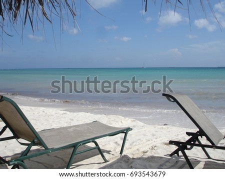 Caribbean beach with sunbeds and calm branding
