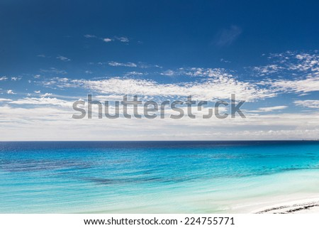 Caribbean beach with white sand and turquoise water, Cancun - stock photo