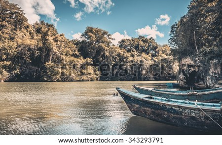 Caribbean blue wooden boats somewhere in Dominican Republic - stock photo