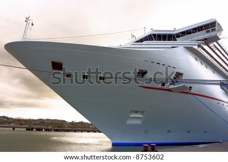 Caribbean Cruise Ship docked on the island of Antigua - stock photo