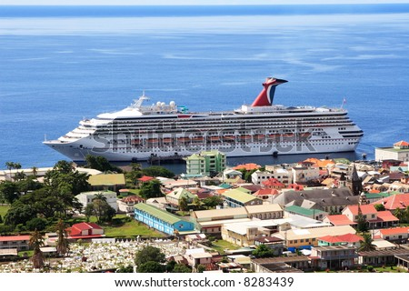 Caribbean Cruise Ship docked on the island of Dominica - stock photo