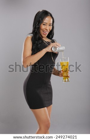 Caribbean girl and a cold drink - stock photo