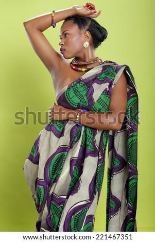 Caribbean girl in pattern fabric tunic - stock photo