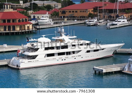 Caribbean Mega Yacht docked on the island of St. Thomas - stock photo
