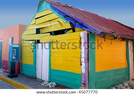 Caribbean Mexican aged grunge vintage colorful wooden house - stock photo