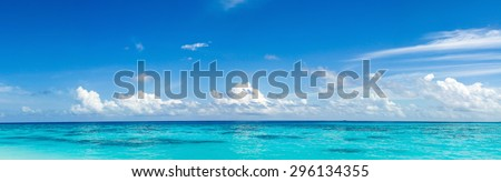 Caribbean panorama Hawaiian Maldivian Bahamian coast with a boat in a turquoise tropical sea - stock photo