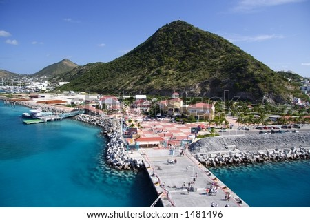 Caribbean pier with fantastic blue water - stock photo