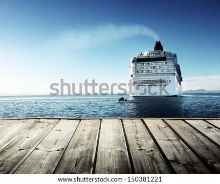 Caribbean sea and cruise ship and wood pier - stock photo