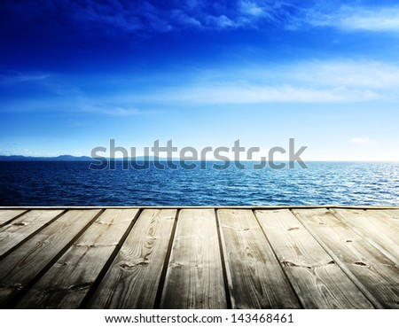 Caribbean sea and wooden platform - stock photo