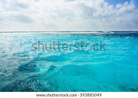 Caribbean sea bottom with blue water wave background in Cuba. Tropical summer sea paradise. Heaven view of deep transparent ocean. Sunshine reflection on a calm sea. Tranquility of turquoise sea.  - stock photo