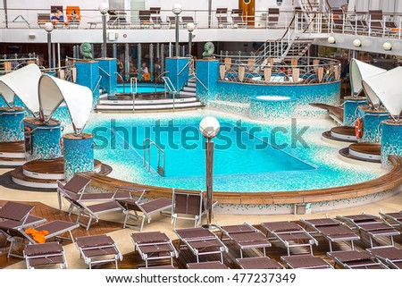 Caribbean Sea - January 07, 2016: Passengers enjoy a day at sea on the top deck of the MSC ORCHESTRA cruise ship during a cruise in the Caribbean Islands.