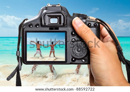 Caribbean Sea vacations with DSLR camera - stock photo