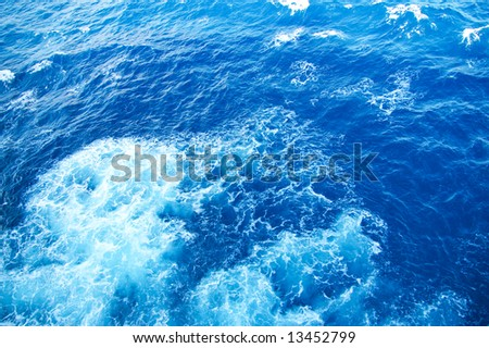 caribbean sea waves in white an blue colors - stock photo