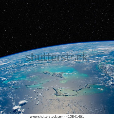 Caribbean seascape from space with stars above. Elements of this image furnished by NASA. - stock photo