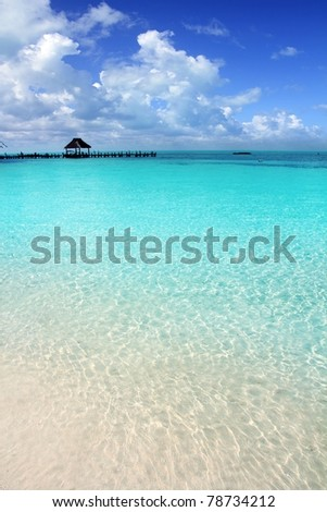 Caribbean tropical beach cabin pier Contoy island Mexico - stock photo
