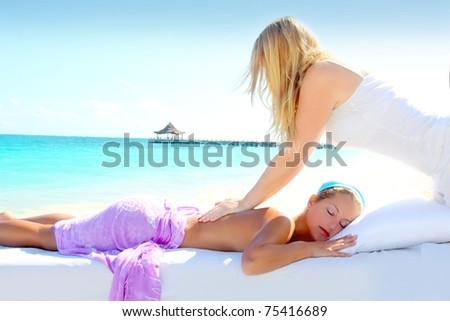 Caribbean turquoise beach chiropractic massage therapy woman - stock photo