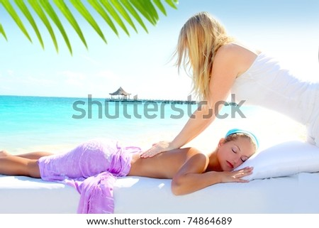 Caribbean turquoise beach chiropractic massage therapy woman [Photo Illustration] - stock photo