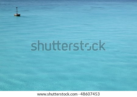 Caribbean turquoise sea with floating buoy far away - stock photo