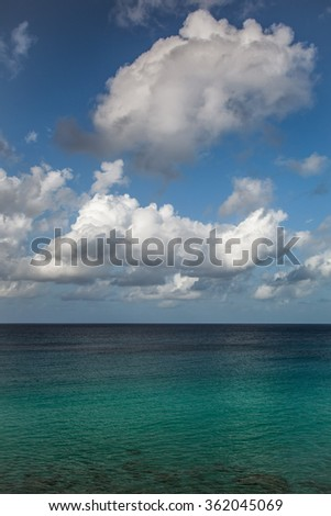 Caribbean view with ocean and sky with clouds - stock photo