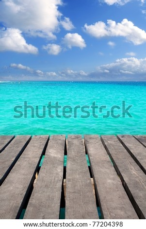 Caribbean wood pier with turquoise aqua sea blue sky Mayan Riviera - stock photo