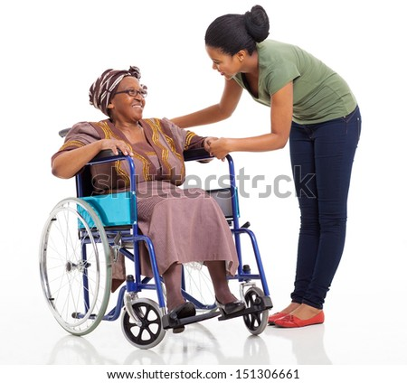 caring african girl talking to disabled senior mother on white background - stock photo