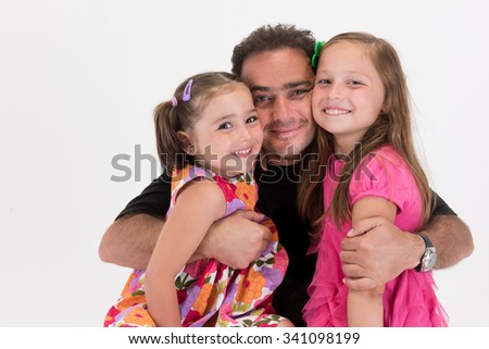 Caring daddy hugging and cuddling his children - stock photo