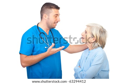Caring doctor giving explanation to a senior woman patient  isolated on white background