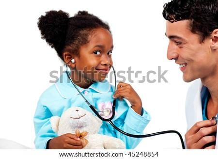 Caring doctor playing with his young patient against a white background - stock photo
