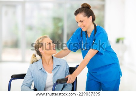 caring doctor with middle aged patient in office - stock photo