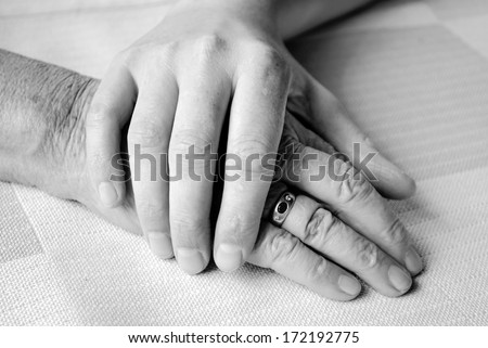 caring hand of a nurse and a senior patient - stock photo