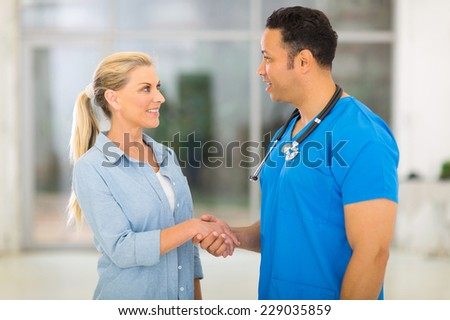 caring medical doctor greeting senior patient - stock photo