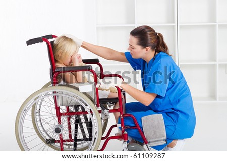 caring medical worker comforting little patient - stock photo