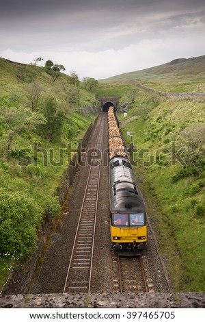 Carlisle, England - July 2, 2015: A Class 60 locomotive hauling a freight train of timber through Blea Moor Tunnel on the Settle-Carlisle Railway in the remote Yorkshire Dales National Park.