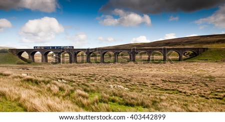 Carlisle, England - May 24, 2011: A Northern Rail Class 158 diesel passenger train crossing Dandry Mire Viaduct on the Settle-Carlisle Railway in the Yorkshire Dales National Park. - stock photo
