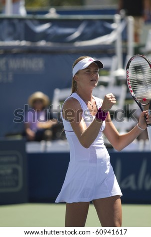 CARLSBAD, CA - AUGUST 05: Daniela Hantuchova of Slovakia celebrates her victory over Jie Jheng at the Mercury Insurance Open at La Costa Resort and Spa in Carlsbad, CA, on August 5, 2010. - stock photo