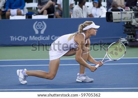 CARLSBAD, CA - AUGUST 08: Maria Kirilenko of Russia awaits her partner's serve in the doubles final at the Mercury Insurance Open at La Costa Resort and Spa in Carlsbad, CA, on August 8, 2010.