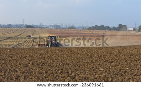 CARME YOSEF, ISRAEL-CIRCA OCTOBER 2014: Agricultural machinery, working in the field