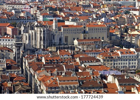 Carmo Convent, Santa Justa Elevator and rooftops of the historical Baixa District (downtown) of Lisbon, Portugal. - stock photo