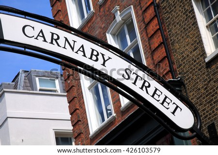 Carnaby Street sign in London's Westminster England. This is were the 1960's hippy flower power fashion started