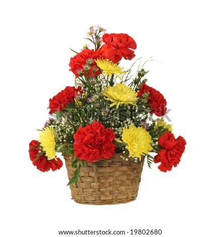 Carnation and mum flowers arrangement in a basket isolated on white