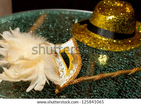 Carnaval mask with hat on the table - stock photo